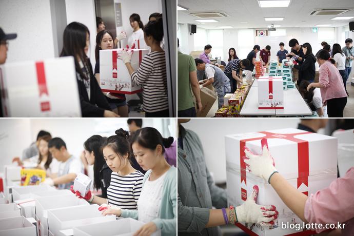 소아암 어린이를 위한 플레저박스 포장을 시작하는 자원봉사자들